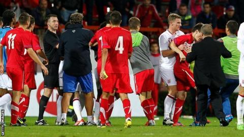 England U21 and Serbia U21 players clash