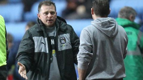 Sky Blues boss Mark Robins discusses tactics with Preston counterpart Graham Westley