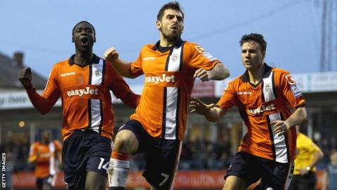 Luton's Alex Lawless celebrates his winning goal against Wolves