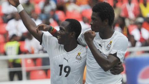 Ghana's Emmanuel Agyemang-Badu and Asamoah Gyan (right)