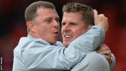 Coventry manager Mark Robins celebrates with assistant Steve Taylor