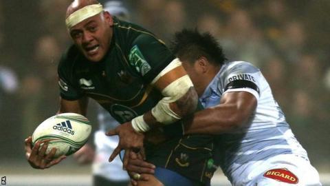 Northampton prop Soane Tongauiha is tackled by Castres Joe Tekori