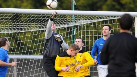 H&W Welders keeper Mark Miskelly punches clear in the Mourneview Park tie against Glenavon