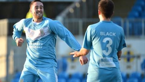 There's a big smile from Shane Dolan after the striker puts Ballymena United ahead against Warrenpoint Town at the Showgrounds