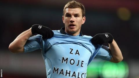 Edin Dzeko celebrates after scoring Manchester City's second goal