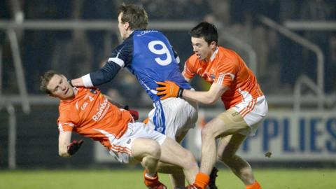 Armagh's Finnian Moriarty and Aidan Forker attempt to dispossess Gearoid McKiernan of Cavan at the Athletic Grounds