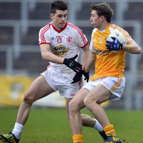 Darren McCurry of Tyrone in McKenna Cup action against Antrim's Sean Finch at Casement Park
