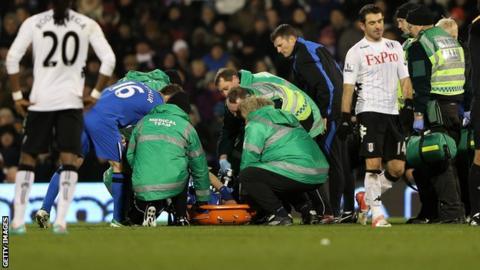 Wigan Athletic defender Ivan Ramis receives treatment for his knee injury at Fulham