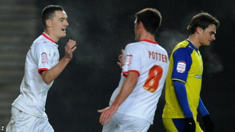 Shaun Williams (left) celebrates his goal