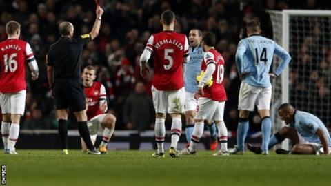 Vincent Kompany (right, on ground) is sent off against Arsenal