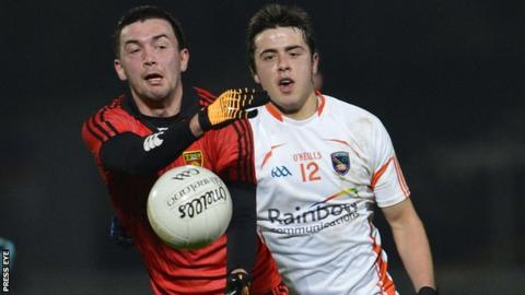 Damian Turley battles with Stefan Campbell at Newry
