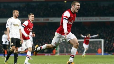 Jack Wilshere celebrates scoring