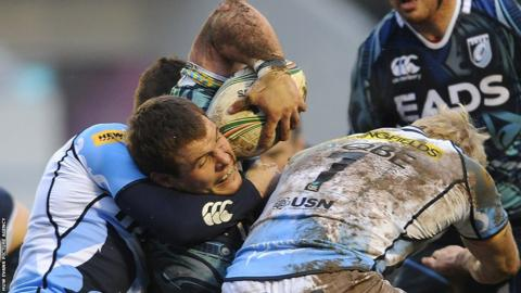 Cardiff Blues prop Sam Hobbs is tackled by Sale's Tom Brady and David Seymour