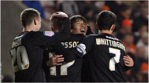 Cardiff City celebrate a Kim Bo-Kyung goal.