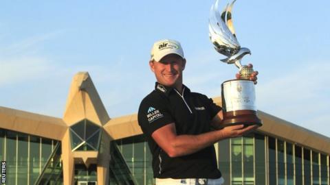 Jamie Donaldson proudly displays the Abu Dhabi Championship trophy