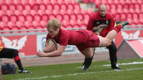Llanelli's Aled Davies dives in to score a try in his side's 40-17 win over Moseley which saw them advance in the British & Irish Cup.
