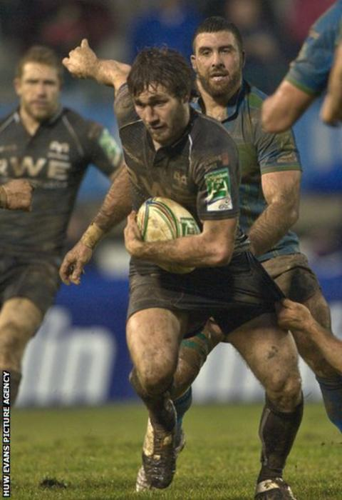 Andrew Bishop launches an attack as the Ospreys concluded their Heineken Cup campaign against Treviso in Italy.