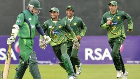 Pakistan players celebrate after taking the wicket of Ed Joyce at Stormont in 2011