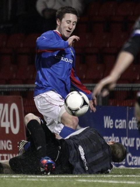 Linfield's Michael Carvill has a penalty appeal turned down after this incident with Crues keeper Craig Hyland