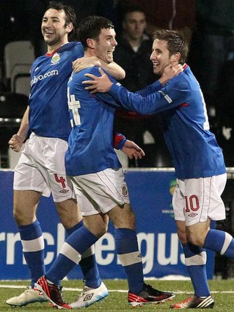 Linfield players celebrate taking the lead in the 27th minute through a superb strike by Brian McCaul