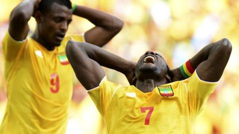 Ethiopian players react during their game against Zambia