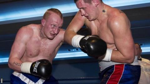 Gary Cornish trades blows with Hungarian fighter Tamas Bajzath