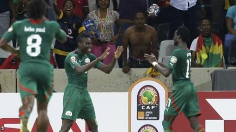Alain Traore, center, celebrates scoring his opener against Ethiopia