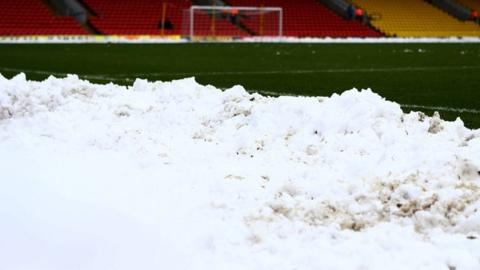 Snow on a football pitch