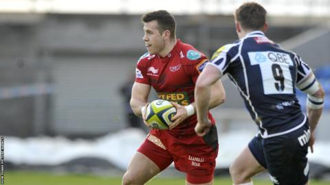 Scarlets scrum-half Gareth Davies looks for a pass during the LV= Cup match against Sale.