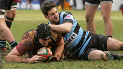 Miles Normandale crashes over to score a try for Cardiff Met in their Swalec Cup match against Cardiff at the Arms Park.