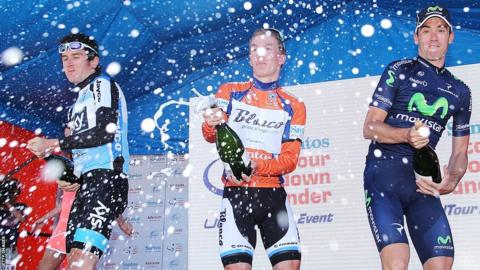 Geraint Thomas (left) cracks open the champagne along with Tom-Jelte Slagter and Javier Moreno after finishing third overall after the sixth and final stage of the Tour Down Under.
