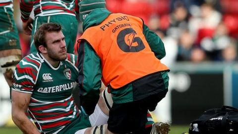 Tom Croft gets treatment during Saturday's game against Wasps