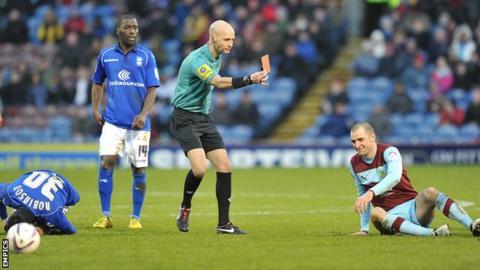 Burnley's Dean Marney is shown a red card against Birmingham
