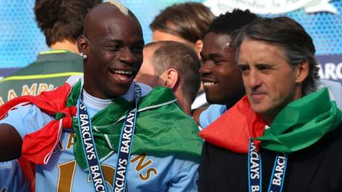 Mario Balotelli with Roberto Mancini