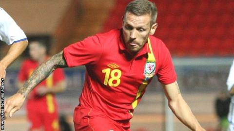 Craig Bellamy in action for Wales.