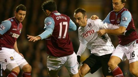 Fulham's Dimitar Berbatov and West Ham players