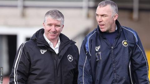Martin Ling (right) has left Torquay in the hands of his assistant Shaun Taylor (left)