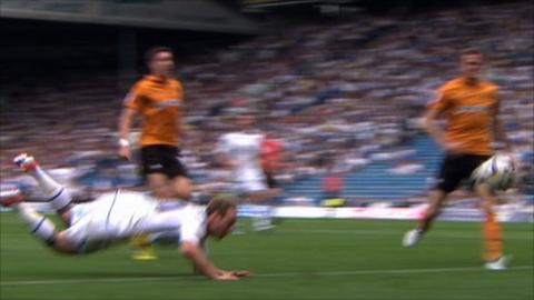 Luciano Becchio scores a diving header