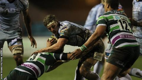 Cardiff Blues' Thomas Young is tackled by Jonathan Joseph