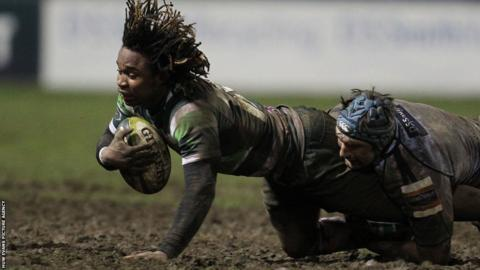 London Irish's Marland Yarde is tackled by Cardiff Blues' Michael Paterson during the Welsh side's 10-6 LV=Cup win at the Arms Park.