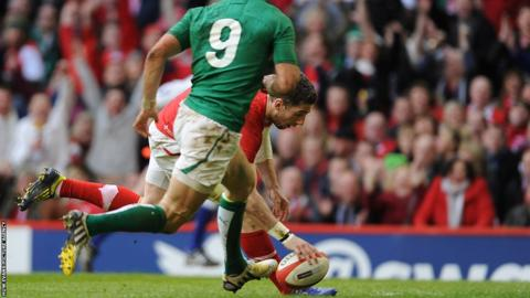 Wing Alex Cuthbert scythes through to add a second Wales try against Ireland