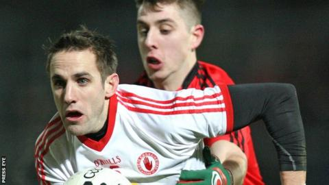 Tyrone's Mark Donnelly attempts to burst away from Ryan Boyle
