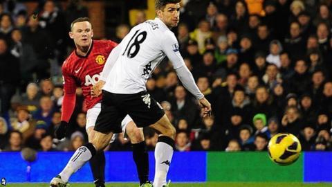 Manchester United striker Wayne Rooney (left) scores his side's winner at Fulham