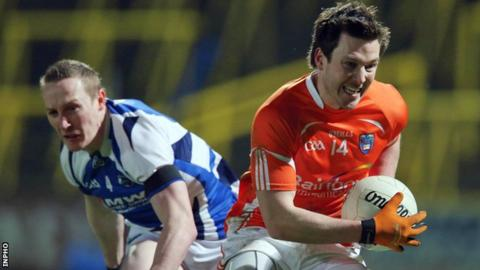 Armagh's Stefan Forker bursts away from Laois player Peter O'Leary