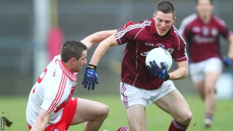 Galway's Danny Cummins fends off Derry's Ryan Ferris at Salthill