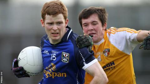 Antrim defender Niall Delargy challenges Cavan's Niall McDermott