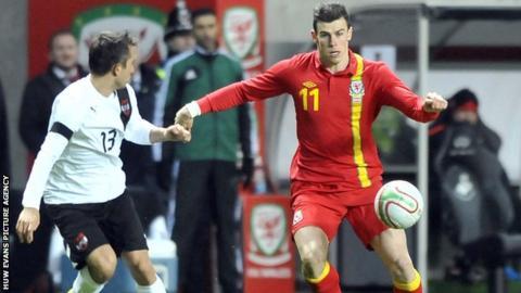 Gareth Bale takes on Austria full-back Markus Suttner
