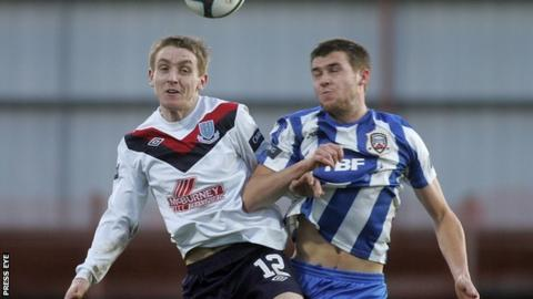 Ally Teggart of Ballymena United in action against Coleraine's Stephen Lowry