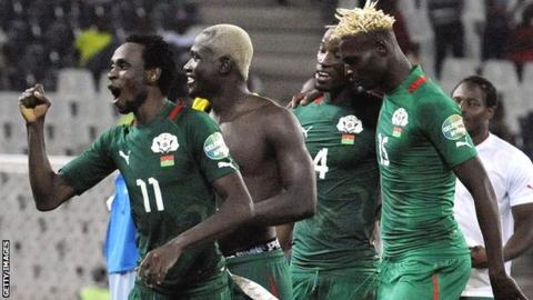 Burkina Faso winger Jonathan Pitroipa celebrates with teammates