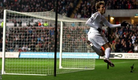 Michu celebrates after giving Swansea City an eighth minute lead in their home Premier League match against Queens Park Rangers.